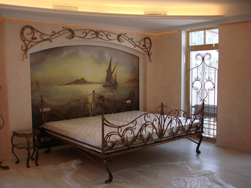 Muursticker aan het hoofdeinde van het bed - een eenvoudige en stijlvolle designkamer