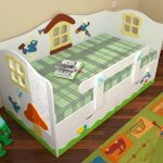 vauvan sänky, jossa on sivut ja laatikko