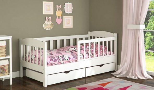 lit bébé blanc