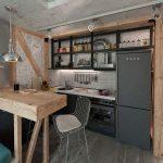 Cuisine de style loft avec des éléments en bois et en métal