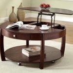 Table transformable ronde avec un mécanisme de levage
