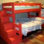 Un lit à deux niveaux avec une commode en rouge