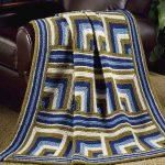 Plaid à motifs géométriques, à tricoter