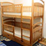 Lit superposé pliable pouvant être transformé en deux lits simples
