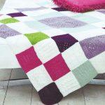 Plaid d'échecs avec carrés tricotés multicolores