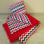 Zigzags en peluche rouge et multicolores pour un plaid brillant