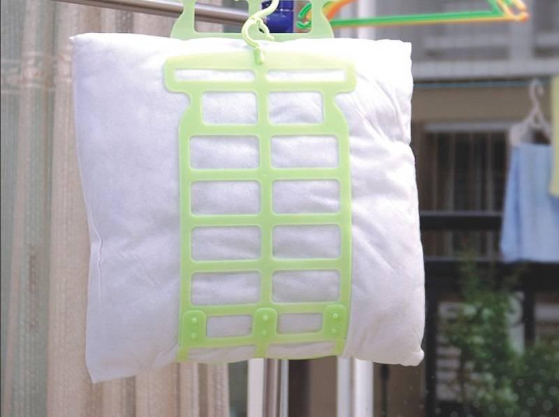hoe kussens uit holofiber te wassen