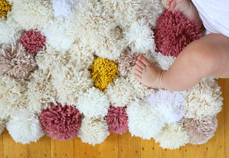 tapis fait de pompons faites le vous même photo