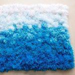 tapis de pompons sur le sol