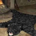 tapis de peau de pompons