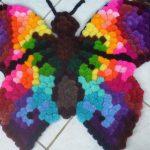 tapis papillon pompon